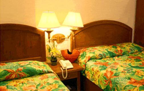 苹果树套房酒店 - 宿务 - 睡房