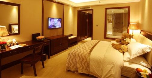 Henan Hairong Hotel - 郑州 - 睡房