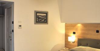 蕾佳娜酒店 - 格拉多 - 睡房