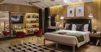 布朗斯中心酒店 - 里斯本 - 睡房