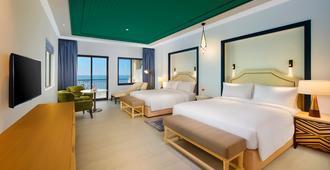 拉斯凯马希尔顿水疗度假酒店 - 拉斯海玛 / 哈伊马角 - 睡房