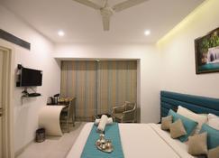 威特兹沙拉纳姆酒店 - 塔那 - 睡房