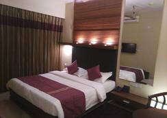Nirvana Inn - 阿克拉 - 睡房