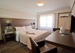 库里奇巴中央宫殿斯拉维耶罗必须酒店 - 库里提巴 - 睡房