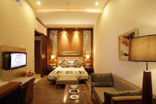 巨量酒店 - 新德里 - 睡房