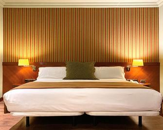 托雷曼加纳酒店 - 昆卡 - 睡房