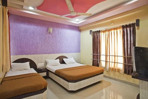 Hotel Disha Palace - Shirdi - 睡房