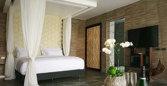 马坎达海边酒店 - 曼努埃尔安东尼奥 - 睡房