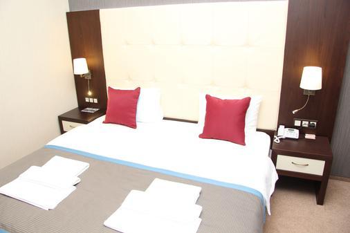 坲沃尔德公寓酒店 - 索契 - 睡房