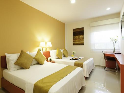 美利达阿塔布里萨米西翁快捷酒店 - 梅里达 - 睡房