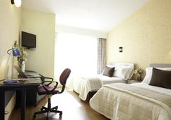 阿瓜斯卡连特斯北部新区米森快捷酒店 - 阿瓜斯卡连特斯 - 睡房