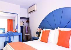 米西翁阿瓜斯卡连特斯卵苏尔酒店 - 阿瓜斯卡连特斯 - 睡房