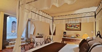 米松阿坎吉尔普埃布拉酒店 - 普埃布拉 - 睡房