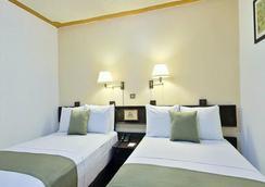 米西翁哈拉帕拉斯公约广场酒店 - 哈拉帕 - 睡房