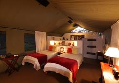 Elephant Valley Lodge - 卡萨内 - 睡房