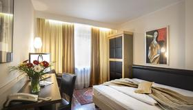 慕尼黑里沃利酒店 - 慕尼黑 - 睡房