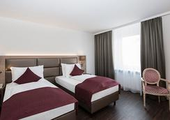 萨尔茨堡因姆劳尔皮特酒店 - 萨尔茨堡 - 睡房