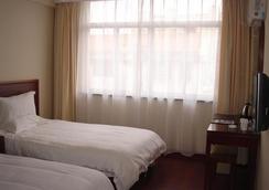格林豪泰江苏省南通市通州区汽车站快捷酒店 - 南通 - 睡房