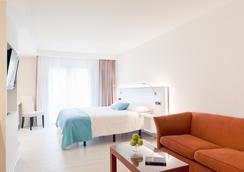 拉特拉萨Spa酒店 - 萨卡罗 - 睡房