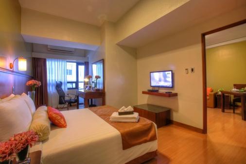 马来亚广场酒店 - 马尼拉 - 睡房