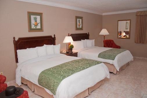 迈阿密跑道旅馆 - 迈阿密泉 - 睡房