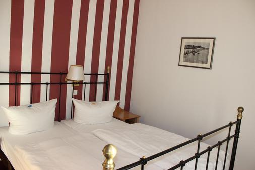 施劳斯维比斯酒店 - 塞巴特黑灵斯多夫 - 睡房
