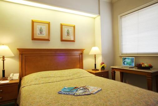 Sunny Bay Suites - 马尼拉 - 睡房