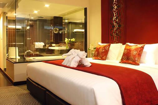 西隆富丽华酒店(原西隆尤尼可大酒店) - 曼谷 - 睡房
