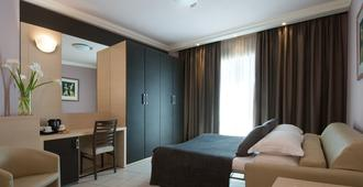 斯佩齐亚cdh酒店 - 斯培西亚 - 睡房