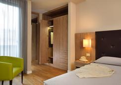 罗西尼酒店 - 佩萨罗 - 睡房