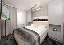 Si套房酒店 - 斯图加特 - 睡房