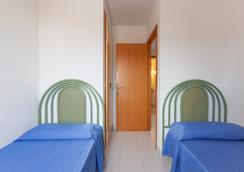 因特尔靠普威望滨海宫酒店 - 普拉亚登博萨 - 睡房
