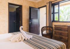 巴里奥拉丁酒店 - 卡曼海灘 - 睡房