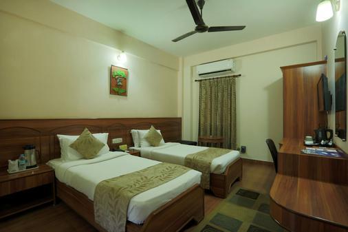 南丹酒店 - 古瓦哈蒂 - 睡房