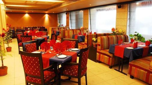 维士瓦拉塔纳酒店 - 古瓦哈蒂 - 餐馆