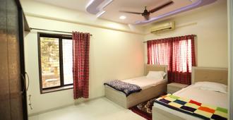 宿舍工厂酒店 - 孟买 - 睡房