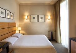 安巴夏特利酒店 - 里米尼 - 睡房