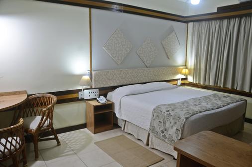 伊瓜苏殖民风格酒店 - 伊瓜苏 - 睡房