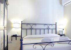 Hotel Domominore - 阿尔盖罗 - 睡房