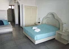 费拉蓝色套房及温泉酒店 - 费拉 - 睡房