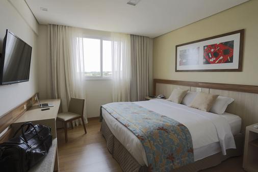 马布恩特尔鲁迪乌伊瓜公约酒店 - 伊瓜苏 - 睡房