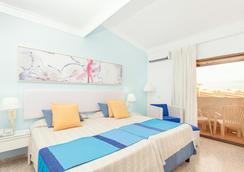 比莱夫体验拉莫拉斯酒店式酒店 - 巴拉德罗 - 睡房