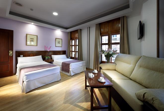 艾克塞特里安佛酒店 - 格拉纳达 - 睡房
