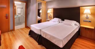 霍斯潘迪姆戈马别墅酒店 - 萨拉戈萨 - 睡房