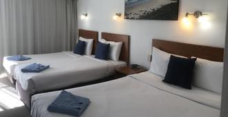 欧卡尔港金链花汽车旅馆 - 麦夸里港 - 睡房