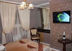 大师与玛格丽特酒店 - Irkutsk - 睡房