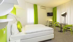 巴塞尔城市客栈酒店 - 巴塞尔 - 睡房