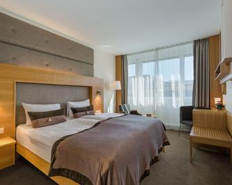 洛桑市大陆酒店 - 洛桑 - 睡房