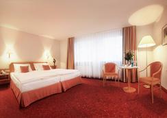 蒂安尼公园酒店 - 莱比锡 - 睡房