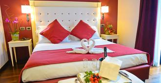 特瑞鲁萨皇宫会议中心温泉酒店 - 罗马 - 睡房